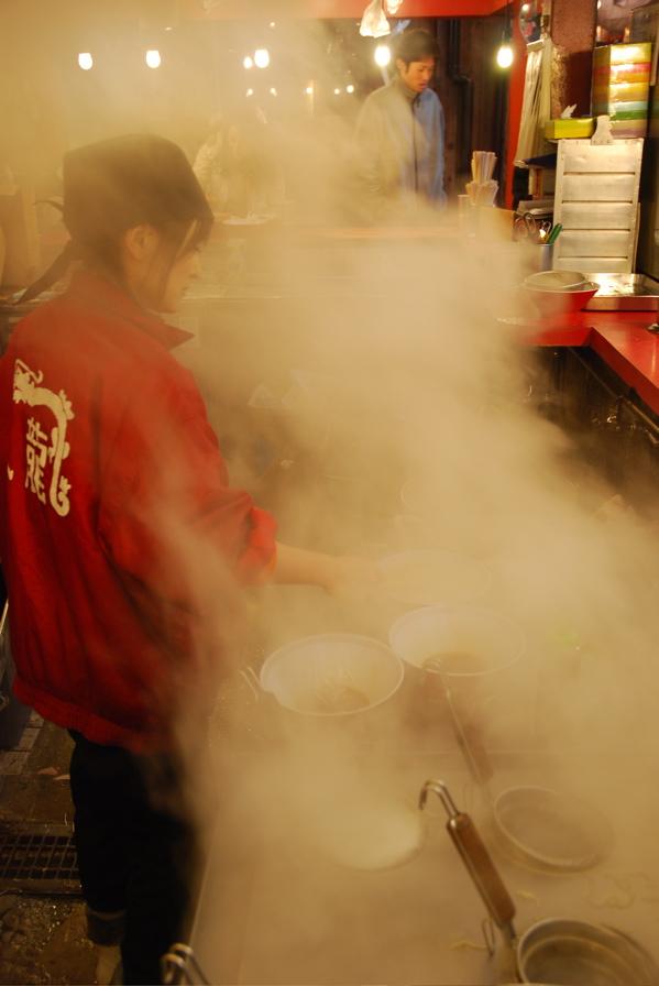 Ramen cook and customer through steam
