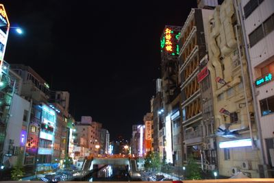 Canal with neon and buildings