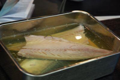 Fish in its curing liquid