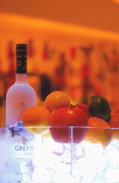 Grey goose bottle and fruits vertical