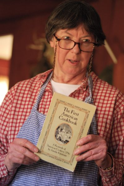 Sally holding The First American Cookbook