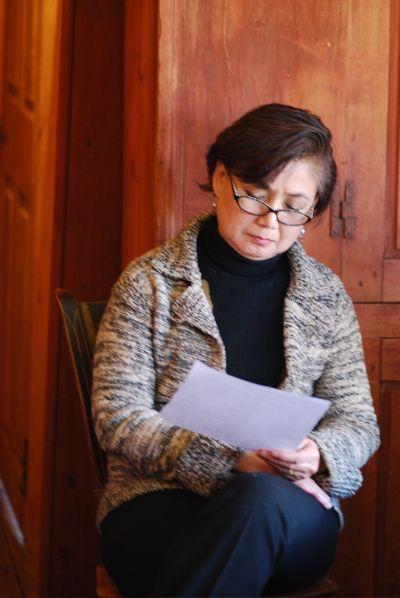 Saori reading through list of letters