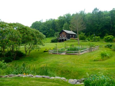 Back yard with garden and school house