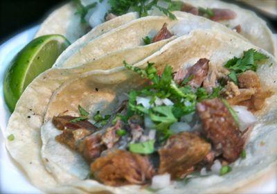 Pork carnitas - pork like confit cilantro onion red and green salsa lime